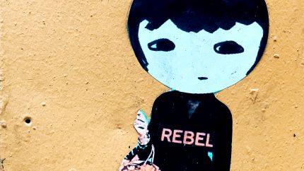 Rebel Girl Photo by Jon Tyson on Unsplash